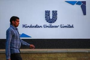 A pedestrian walks past the Hindustan Unilever Limited (HUL) headquarters in Mumbai.