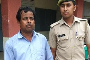 A photo of the accused, Chandi Das (left) who was arrested for the alleged rape of a three-and-a-half-year old girl inside a Greater Noida-based private school. Das is a life guard at the school.