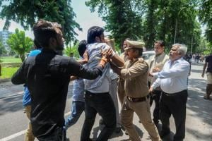 Protestors at Lucknow University being detained by police, in Lucknow.