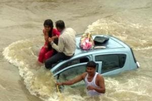 Villagers help the passengers reach the river bank at Taloja.