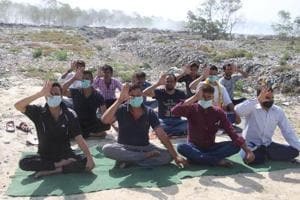 On the occasion of International Yoga Day on June 21, residents in Haldwani practised yoga at a trenching ground wearing masks to highlight their plight.