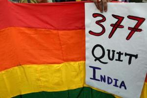 In this file photo taken on December 15, 2013, a gay rights activist holds up a placard against Section 377 during a protest against the Supreme Court ruling reinstating a ban on gay sex, in Kolkata.