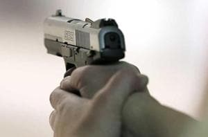 A country-made firearm and five live cartridges were recovered from the scene of the crime.