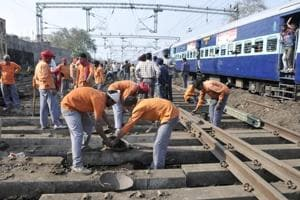 Workers repairing the railway tracks in Ludhiana.