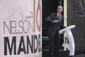 Former US President Barack Obama speaks during the 2018 Nelson Mandela Annual Lecture at the Wanderers cricket stadium in Johannesburg on July 17, 2018.