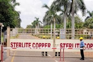 A private security guard stands in front of the main gate of Sterlite Industries Ltd