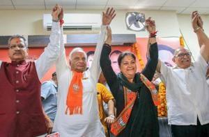 Rajasthan BJP president Madan Lal Saini raises hands with BJP senior leader Om Mathur, Rajasthan chief minister Vasundhara Raje and former president Ashok Parnami at BJP Office, in Jaipur.