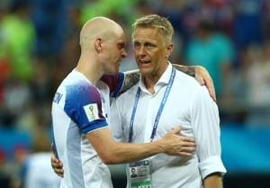 Heimir Hallgrimsson talks with with Emil Hallfredsson at the end of their FIFA World Cup 2018 match.