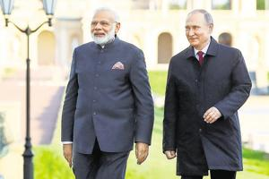 Prime Minister Narendra Modi, left, and Russian President Vladimir Putin walk at the St Petersburg International Economic Forum in  Russia, on June 1, 2017.