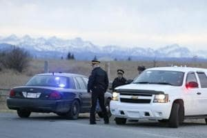 Royal Canadian Mounted Police (RCMP) officers man a road block leading to a Muslim cemetery near Cochrane, Canada.