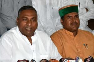 Former MLA Mohammad Shahzad (L) addresses a press conference in Dehradun on Wednesday.
