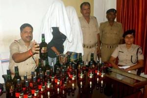 RPF team of Dhanabd with the two arrested persons who were smuggling Indian Made Foreign Liquor via train to Bihar in Dhanbad.
