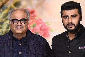 Indian Bollywood film producer and director Boney Kapoor (C) poses for a picture with his son Arjun Kapoor during the wedding reception of actress Sonam Kapoor and businessman Anand Ahuja.