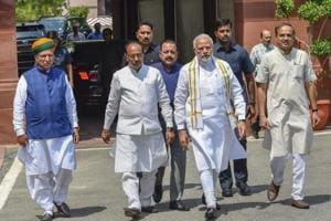 Prime Minister Narendra Modi arrives to address the media ahead of the monsoon session. Parliamentary affairs minister Ananth Kumar (right) is also seen.