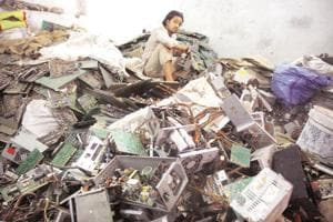 People working at e-waste market at Seelampur in New Delhi.