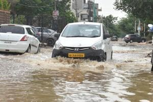 A waterlogged road in Gurugram's sector 45  following rains on July 15, 2018.