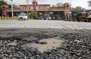 Potholes at Modela check naka in Thane.