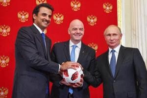 (From L) Emir of Qatar Sheikh Tamim bin Hamad Al-Thani, FIFA President Gianni Infantino and Russian President Vladimir Putin pose for a photography during a symbolic transfer of the authority to Qatar to host the World Cup 2022 at the Kremlin in Moscow on July 15, 2018.