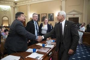 Dave Reichert (right), chairman of the House Subcommittee on Trade, reaches out to shake hands with witnesses who testified about the effect of foreign tariffs on American agriculture, on Capitol Hill in Washington.