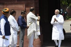Prime Minister Narendra Modi (right) is greeted by Parliamentary affairs minister Ananth Kumar, Union MoS for Parliamentary Affairs Vijay Goel, MoS Arjun Ram Meghwal as he arrives to address the media ahead of the Monsoon session of Parliament in New Delhi, on July 18, 2018.