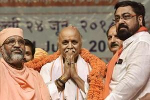 Former Vishwa Hindu Parishad leader Pravin Togadia being garlanded by the supporters at the launch of his new outfit International Hindu Council.