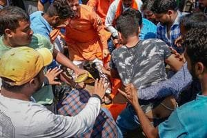Alleged Bharatiya Janata Yuva Morcha (BJYM) workers assault social activist Swami Agnivesh during his visit to Pakur on July 17.