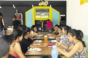 Students at the canteen of a serviced apartment called Youthville.