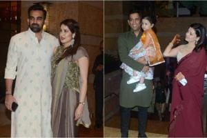 Zaheer Khan with wife Sagarika Ghatge and Mahendra Singh Dhoni with daughter Ziva and wife Sakshi.