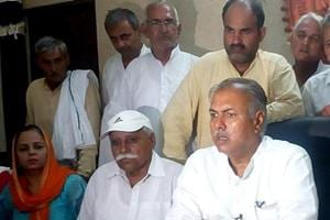 All India Jat Aarakshan Sangharsh Samiti president Yashpal Malik (right) during a press conference at Jassia village in Rohtak district on Thursday.