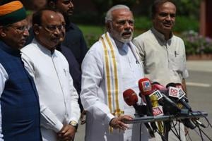 Narendra Modi stands with senior BJP leaders as he addresses media after arriving for the monsoon session of Parliament in New Delhi on Wednesday.