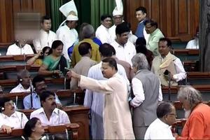 Biju Janata Dal (BJD) members walk out of the Lok Sabha during a debate on