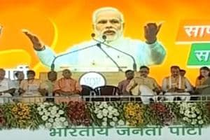UIttar Pradesh chief minister Yogi Adityanath and other BJP  leaders listen to Prime Minister Narendra Modi at the  Shahjahanapur rally on Saturday.