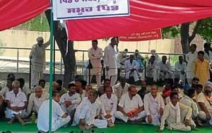 Farmers of Lubaniawali village during a protest at Muktsar in Punjab on Friday.