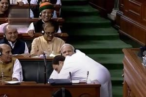 Congress President Rahul Gandhi hugs Prime Minister Narendra Modi after his speech in the Lok Sabha on