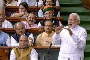 Prime Minister Narendra Modi speaks in the Lok Sabha during the no-confidence motion in Parliament, in New Delhi on Friday.