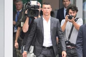 Portuguese footballer Cristiano Ronaldo (C) arrives on July 16, at the Juventus medical center at the Alliance stadium in Turin. Cristiano Ronaldo arrived in Turin ahead of his official unveiling as Juventus