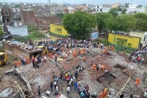 Rescue operations on at the spot where a building collapsed in Ghaziabad on Sunday afternoon.