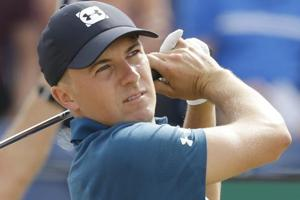 Jordan Spieth plays a shot off the 3rd tee during the third round of the British Open Golf Championship in Carnoustie.