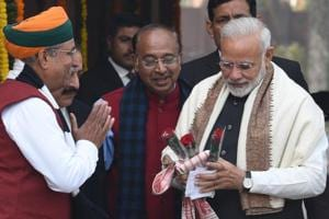 Prime Minister Narendra Modi (right) is welcomed by minister of state Arjun Ram Meghwal (left) for the first day of budget session of Parliament, in New Delhi, in January 2018.