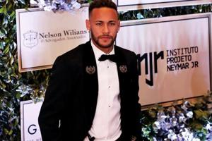 Neymar poses on the red carpet during an auction to raise funds for his Institute Project Neymar Jr in Sao Paulo, Brazil.