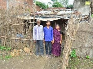 Asharam Chaudhary (18) who will study medicine at AIIMS, Jodhpur having been successful in AIIMS-MBBS entrance examination, 2018 at his thatched house at a town in Madhya Pradesh's Dewas district.
