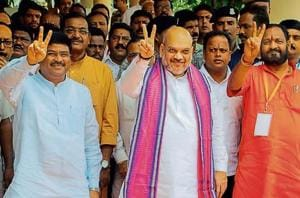 (From L-R) Union petroleum and natural gas minister Dharmendra Pradhan, BJP president Amit Shah and Odisha BJP state chief Basanta Panda in Bhubaneswar in July.