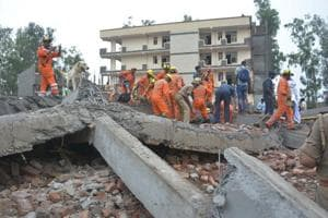 National Disaster Response Force seen carrying out rescue operation after an under-construction building collapsed in Ghaziabad, killing at least one person  at Akash Nagar on Sunday, July 22, 2018.