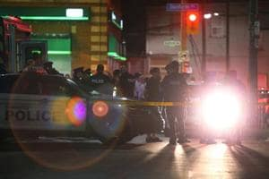 Police officers attend the scene of a mass shooting in Toronto, Canada on July 22.