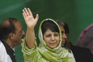 Former Jammu and Kashmir chief minister Mehbooba Mufti waves to supporters in Srinagar,India.