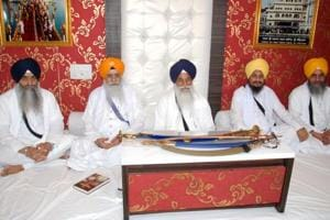 Akal Takht Jathedar Giani Gurbachan Singh (C) with other Sikh high priests during a meeting held at the Akal Takht in Amritsar.