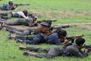 (FILES) In this file photo taken on July 8, 2012 Maoists ready their weapons as they take part in a training camp in Bijapur district in Chhattisgarh.