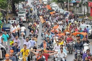 Maratha community members take part in a bike protest rally against the government demanding reservation in Kolhapur on Tuesday.