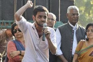 File photo of JNU student Umar Khalid (holding the mike) at a protest march  in New Delhi on March 4, 2017.  Khalid claims the university didn't allow him to submit his PhD thesis despite instructions from Delhi HC.