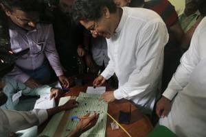Pakistani politician Imran Khan, chief of Pakistan Tehreek-e-Insaf party, casts his vote at a polling station for the parliamentary elections in Islamabad, Pakistan, on Wednesday.